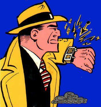 Cartoon character Dick Tracy talking into his wrist watch